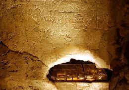 Closer look at the niche in the graffiti wall, on the Tomb of St Peter.