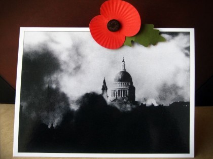 Travel souvenirs. Poppy flower and Saint Paul's Cathedral postcard, England.