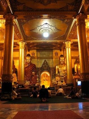 People praying at the Shwedagon Pagoda, Myanmar. Photo: Dr. Sithu Win, Wikipedia.