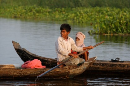 Cultural Travel 101. Children at the Tonle Sap Lake in Cambodia.