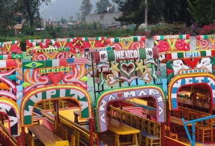 Mexico City, Brightly painted trajineras in Xochimilco. Photo: Wikipedia, Gengiskanhg.