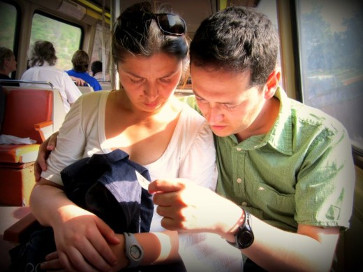 Travel with your spouse. Checking the map inside the Washington Metro.